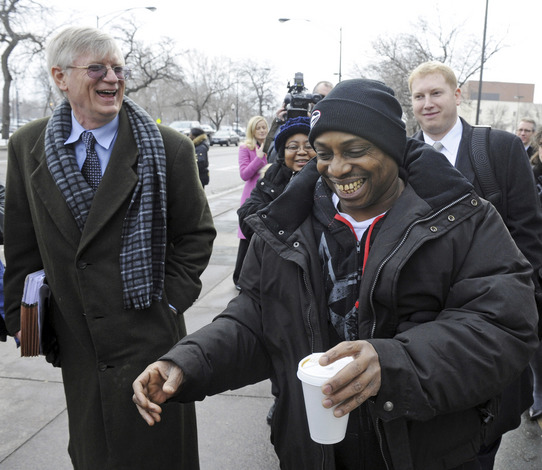 Michael Tillman, wrongfully convicted, with civil rights lawyers Flint Taylor and Ben Elson from People's Law Office